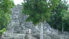 Ancient mayan city Coba pyramid stairs in the hidden jungle and tourist. Mexico Stock Footage