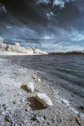 Infrared landscape of lake in English countryside in Summer with surreal colo - stock photo