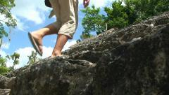 Tourist Legs walk on Ancient mayan pyramid stairs in the hidden jungle. Mexico Stock Footage