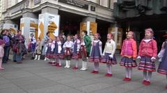 Belarusian children folklore ensemble sing on street . 4K Stock Footage