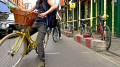 London lifestyle. Women with bicycles near Borough Market in London Stock Footage