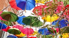 Colourful umbrellas open in the sky as a decoration in London city Stock Footage