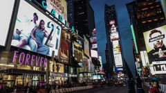 The people walk in Time Square at night in Manhattan, New York City. - stock footage