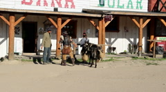 Businessman in the wild west selling goods. American old west Stock Footage