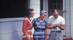 1953: Family laughing about advnaced photography technology. Stock Footage