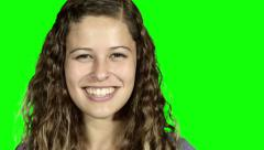Beautiful young woman turns to camera and gives a radiant smile Stock Footage