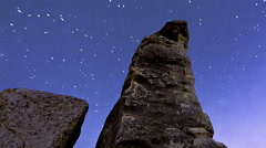 Panning shot of Astronomical time-lapse looking up rock pillars at Mount Arbel. Stock Footage