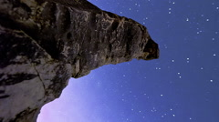Vertical shot of Astronomical time-lapse looking up rock pillars at Mount Arbel. - stock footage