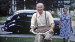 1953: Grandpa's first ride on a bicycle since the 1800's! Stock Footage