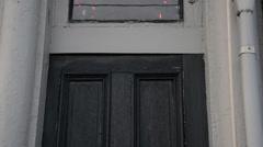 Tilt down, vintage wooden door. Stock Footage