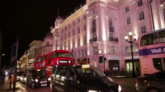 Piccadilly circus at night Red Bus, London, England, Europe Stock Footage