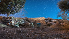Panning shot of Astro time-lapse with olive trees in Bethlehem, Israel Stock Footage