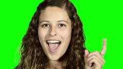 Beautiful young woman frowning to the side, then gets a very bright idea - stock footage