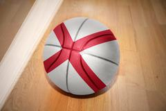 basketball ball with the flag of alabama state - stock photo