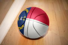 basketball ball with the flag of north carolina state - stock photo