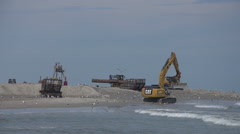 Wide construction vehicles on beach. Stock Footage