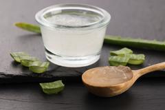 Aloe vera juice with fresh leaves Stock Photos