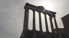 Stock Video Footage of Roman Forum Ancient Imposing Columns Sun Rays Capitolium Rome Antique Site