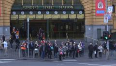 Flinders St Station corner Melbourne Pedestrians HD Stock Footage