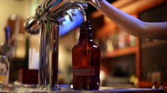 CU bartender fills growler. Stock Footage