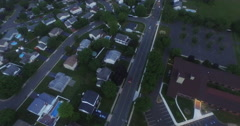 Dusk aerial, suburban neighborhood. Stock Footage