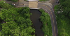 Aerial over a sharp turn on road. - stock footage