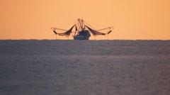 Fishing Boat drops anchor at sunrise Stock Footage
