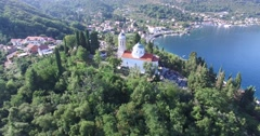 Church on a hill at the entrance to Boka Bay. Kamenari, Montenegro Stock Footage
