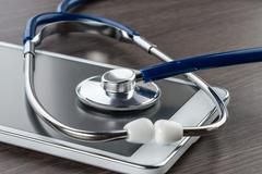 Doctor workplace with digital tablet and stethoscope Stock Photos