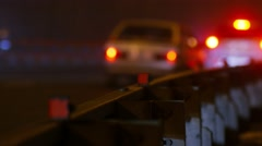 Cars on a freeway at night, backlights, selective focus. Stock Footage