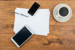 Smart Phone, tablet, paper and drawing pen with coffee - stock photo