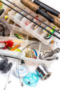 Fishing tackles - rod, reel, line and lures in box Stock Photos