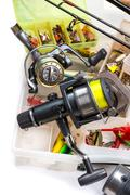 fishing tackles - rod, reel, line and lures in box - stock photo