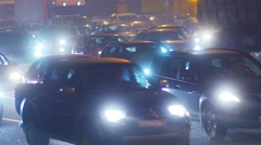 Traffic jam, dense slow flow of cars on a freeway at night. Stock Footage
