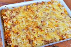 meat casserole with cheese on baking sheet - stock photo