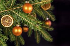 Orange xmas balls on a tree Stock Photos