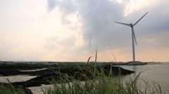 Beautiful landscape with windmills in Jeju island Stock Footage