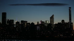 Midtown Manhattan skyline with cloud at sunset in NYC - stock footage