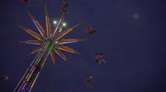 Swing tower ride at amusement park on a cloudy early evening. 4K UHD. Stock Footage