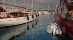 Classic sailing and motor superyachts moored in marina, 4k Stock Footage