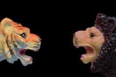 Toy Lion Versus Toy Tiger Stock Photos