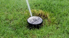 Sprinkler on grass field - stock footage