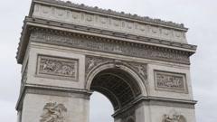 Arc de Triomphe world famous symbol of France and Paris 4K 2160p UltraHD tilt Stock Footage