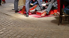London lifestyle. Shoeshiners working in a market in London, United Kingdom Stock Footage