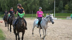 Students riding school with their horses in the arena. Stock Footage