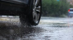 Rainy day in city, car, water drops, puddles, slow motion, selective focus. - stock footage