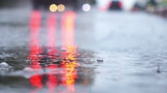 Rainy day in city streets, water drops, puddles, slow motion, selective focus. - stock footage