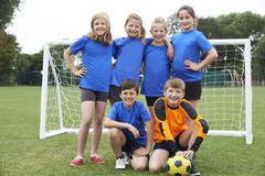 Boys And Girls In Elementary School Soccer Team Kuvituskuvat