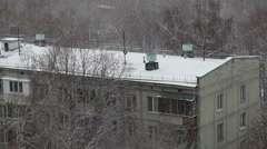 Snow-covered roof of five-story building. Stock Footage