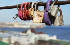 Bridge love of locks on with background of the city - stock photo